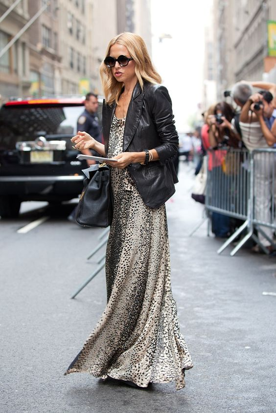 an animal print maxi dress, a black leather blazer and a black bag for a trendy and bold look