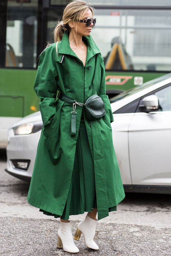 an apple green oversized midi trench, a matching dress, white booties and a dark green bag for a monochromatic look