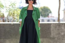 an apple green trenh, a navy midi dress, leggings, striped bright shoes with square toes