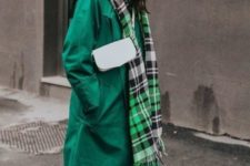 an emerald trench, light-colroed jeans, blakc booties, a checked scarf and a white bag for a bold look