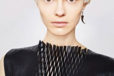 an icy blonde bowl haircut with much texture and enough volume is a cool modern idea