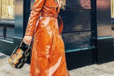 an orange patent leather trench, white trainers and a snakeskin bucket bag for an ultimate spring look
