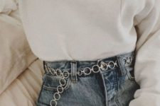 blue high waisted jeans, a white sweatshirt and a silver circle chain belt for an accent