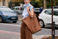 brown culotte shorts, a light blue sleeveless top, bright blue square toe shoes and a brown tote for spring