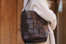 finish off your look with a chocolate brown woven leather bucket bag, which is two trends in one