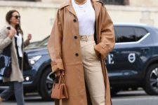neutral high waisted pants, a white tee, neutral wire square toe shoes, a camel leather trench and a small bag