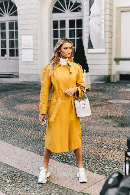 wear your bright trench with trainers and a simple bag not to distract attention from your bold clothes item