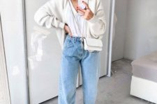 02 a casual outfit with a white top, blue slouchy jeans, white sneakers, a cardgian and a crossbody bag