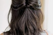 03 a half updo with a twisted ponytail and rather a sleek top is a chic and stylish idea to rock