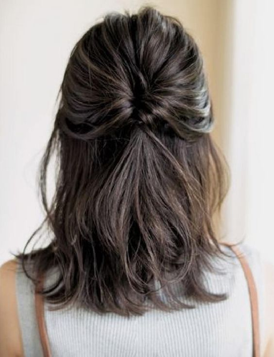 a half updo with a twisted ponytail and rather a sleek top is a chic and stylish idea to rock