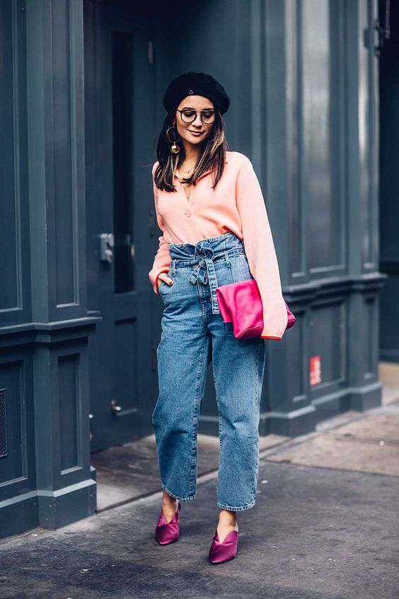 a trendy look with a blush blouse, blue paper bag jeans, fuchsia shoes and a matching clutch plus a beret