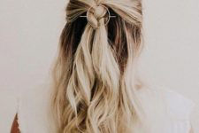 03 a wavy half updo with a braided element and waves down plus an orbital hair pin is a trendy idea