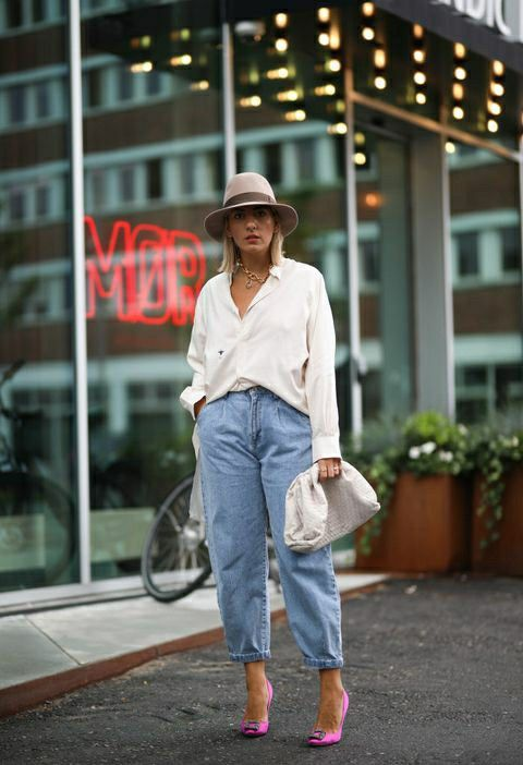 a spring look with a white shirt, blue slouchy jeans, hot pink shoes, a hat and a white clutch
