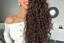 04 even if you don't have curls, you can always make them on your extra long hair for a trendy look