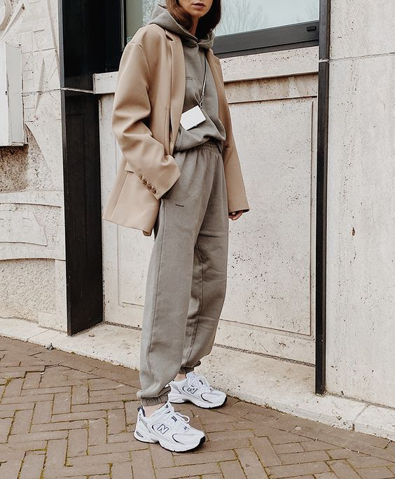 a grey tracksuit with a hoodie is a nice idea for workign at home and you can put on a blazer and trainers if you need to go outside