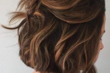 05 a messy half updo with a bump on top and some waves lets you swipe your hair off the face