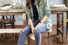 06 a casual look with a black turtleneck, a green cargo jacket, grey skinnies and black booties