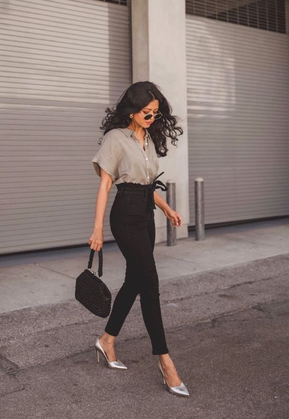 a chic outfit with a grey oversized blouse, black paper bag skinnies, silver shoes and a black bag