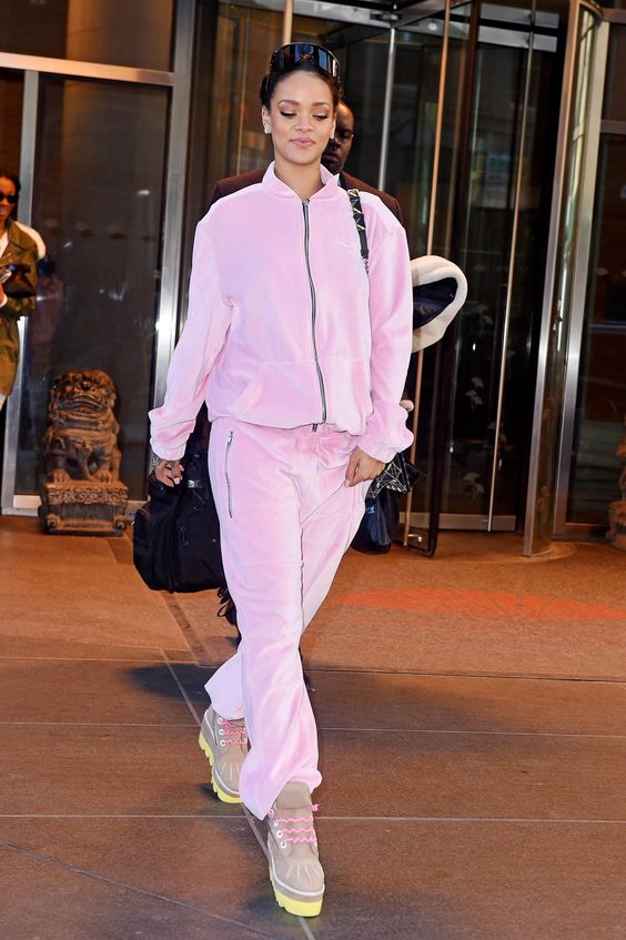 a plush pink tracksuit with a hoodie is a comfy, warm and cute option to wear right now