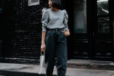 06 a spring look with a grey top with puff sleeves, black slouchy jeans, black booties with spikes and a grey bag