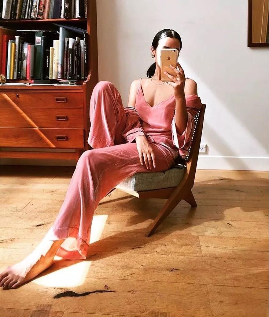 a bright pink pajamas set with a spaghetti strap top, pants and a duster for a chilly day