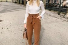 07 a casual fall outfit with a white top, brown velvet paper bag pants, white sneakers and a brown bag