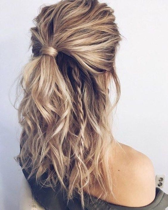 a half updo with a low ponytail and a couple of braids going down is a nice idea for medium length or long hair