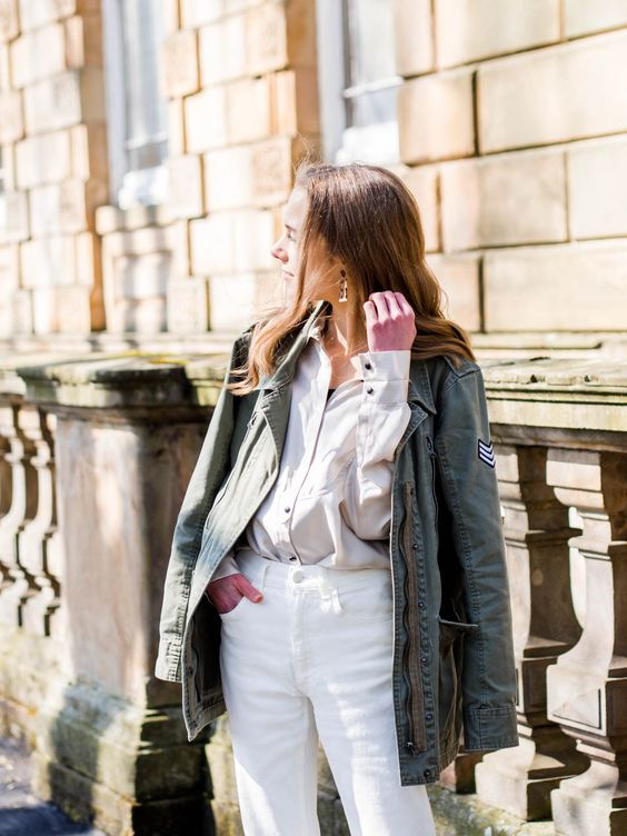 a neutral oversized shirt, white jeans, an olive green cargo jacket for this spring