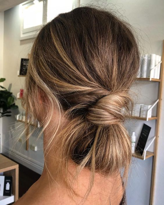 a simple twisted low updo and some locks down plus a casual top for a chic look