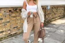 08 a casual look with tan paper bag pants, a white crop top, white sneakers, a cardigan and a camel bag