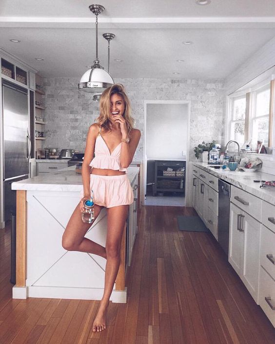 a pink suit with a crop top with a ruffle and mini shorts is sexy and comfy at the same time