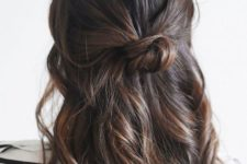 08 a simple wavy half upfo with a messy knot and some locks down is a cool idea for medium hair