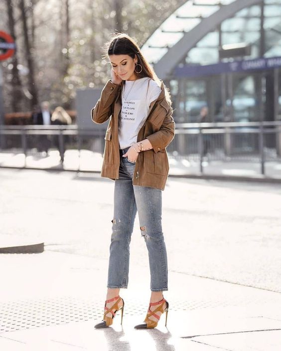 a printed tee, blue cropped jeans, two tone shoes, a brown leather cargo jacket for spring