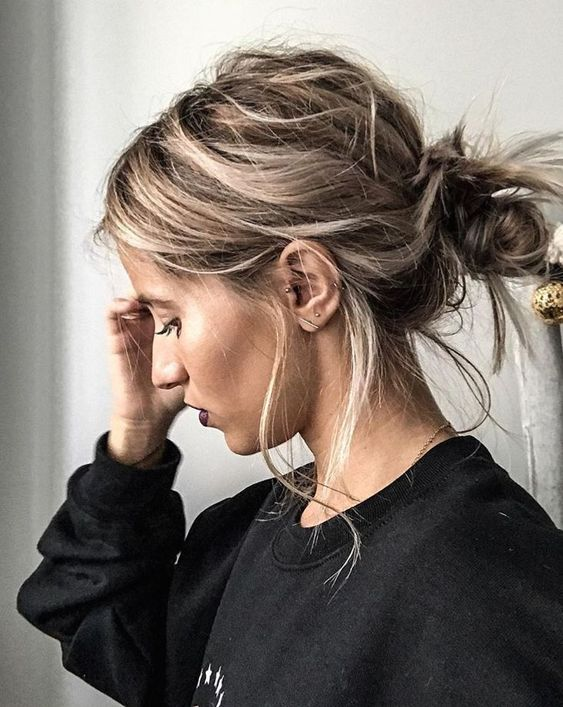 a super messy low bun with locks down is a cool idea that can be made very fast and easily