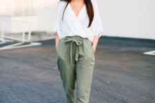 10 a casual spring outfit with a white slouchy blouse, green paper bag pants, black platform shoes