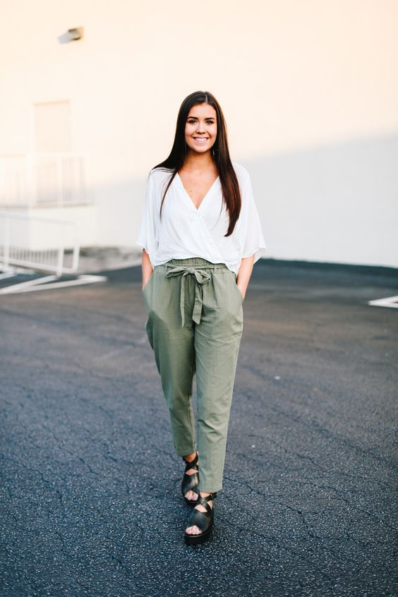 a casual spring outfit with a white slouchy blouse, green paper bag pants, black platform shoes