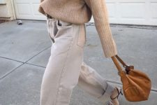 10 a chic outfit with a tan oversized sweater, grey slouchy jeans, embellished shoes and a camel bag