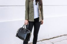 10 a simple look with a printed tee, black skinnies, silver sneakers, an olive green cargo jacket and a black bag