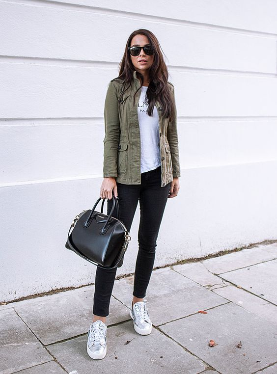 a simple look with a printed tee, black skinnies, silver sneakers, an olive green cargo jacket and a black bag