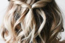 10 a wavy and relaxed half updo with twists, a messy top requires zero skill to make it