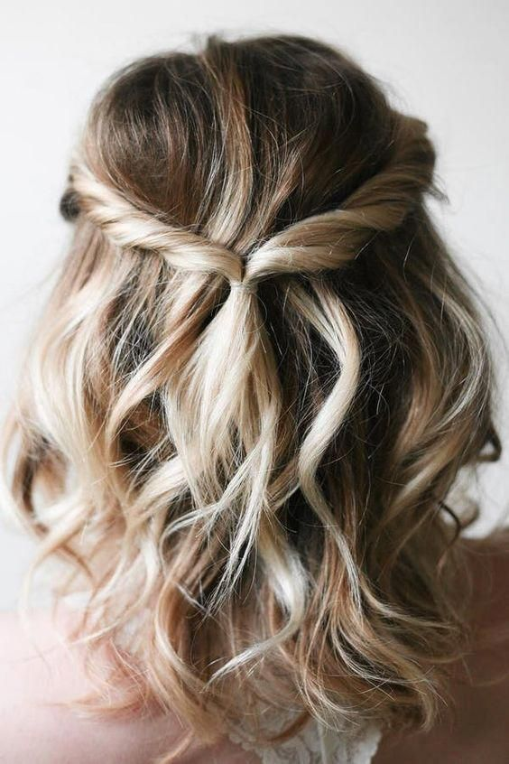 a wavy and relaxed half updo with twists, a messy top requires zero skill to make it