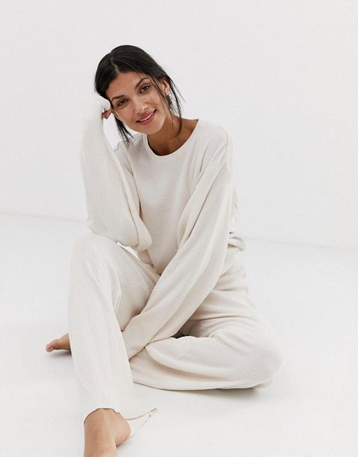a white thin knit homewear suit with an oversized long sleeve top and pants is perfect for now