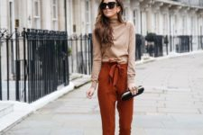 11 a fall look with a tan turtleneck, rust colored cropped pants, animal print shoes and a black clutch