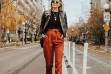 12 a fall outfit with a black top, rust cropped pants, black boots, a black leather jacket