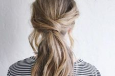 12 a low and messy twisted ponytail with some locks down is a nice idea for medium and long hair