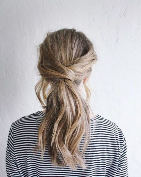 a low and messy twisted ponytail with some locks down is a nice idea for medium and long hair