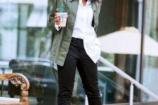 12 a stylish look with black jeans, a white shirt, an olive green jacket, black velvet heels