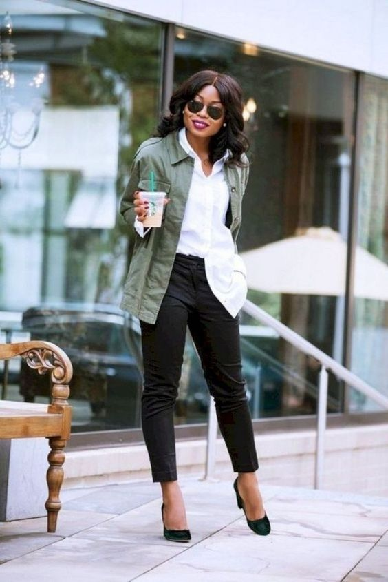 a stylish look with black jeans, a white shirt, an olive green jacket, black velvet heels