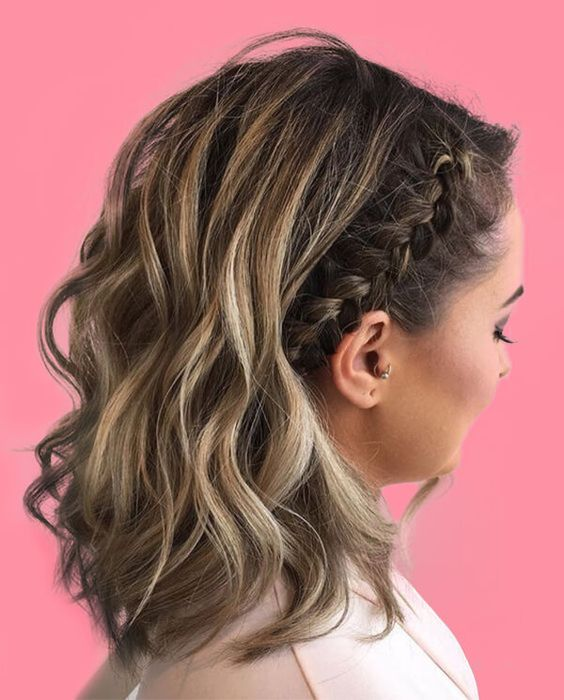 a wavy half updo with a side braid that accents one part and looks pretty and cool