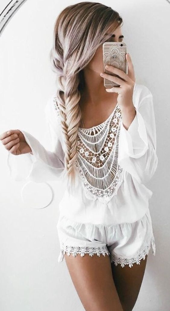 a white boho crochet lace pajama with super short shorts and a top with a macrame front